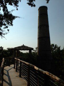 The chimney of the original Alamo Cement kiln still stands and is visible from the Japanese Tea Garden.