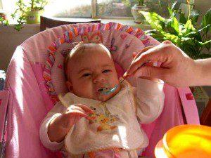 Ilana, not enjoying rice cereal.