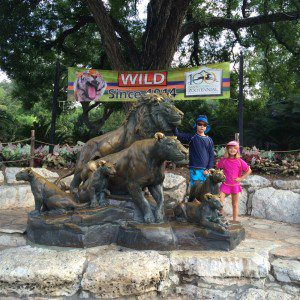 Brother and sister enjoying the San Antonio Zoo.