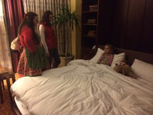 Being tucked in by the JW elves
