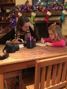 Helping Harper write her letter to Santa in Santa's Workshop