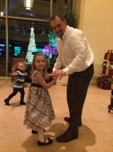 """A little father/daughter dancing in the """"living room"""" after dinner"""