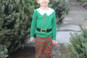 My little elf on the hunt for the perfect Christmas tree.