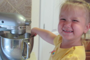 Molly (then 2) helps cook.