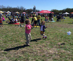 Flying kites at Fest of Tails in McAllister Park