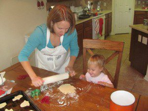 Molly (1) and me (super pregnant) making our own Christmas cookies. At least we get to eat them all ourselves!