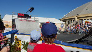 Watching BMX stunts at this year's rodeo.