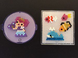 Note the Beados design template on the left with room for one design. The AquaBeads templates typically have 3-5 different designs on each template.
