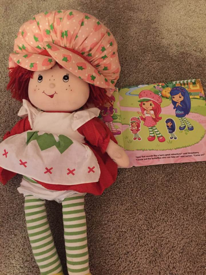 Strawberry Shortcake of the 1980's next to Strawberry Shortcake 2.0.