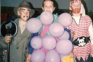 Any kid who can wear balloon grapes has my respect. Also, take note of the axe murderer on the side. Oh, for the more innocent days of the 90s.