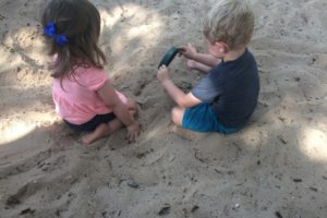 Sandy, fully engrossed kids = happy, chatty moms (until it's time to pull them out and clean them off!)
