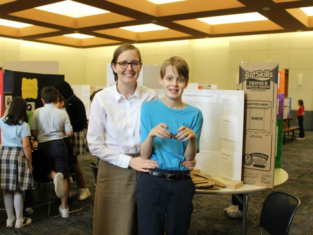 Blogger Inga Cotton with her son, F.T., and HIS science fair project, not OUR science fair project   Alamo City Moms Blog