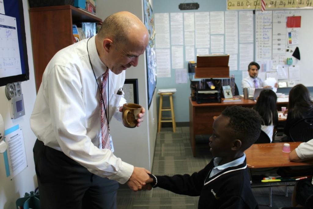 Great Hearts Western Hills Headmaster Robby Kuhlman with student | Alamo City Moms Blog