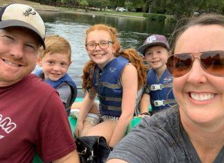 family smiling at camera at landa park in new braunfels texas