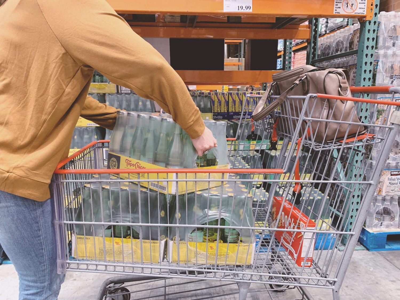 putting topochico into a cart at costco