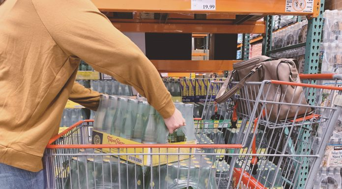 putting topochico into a cart at costco