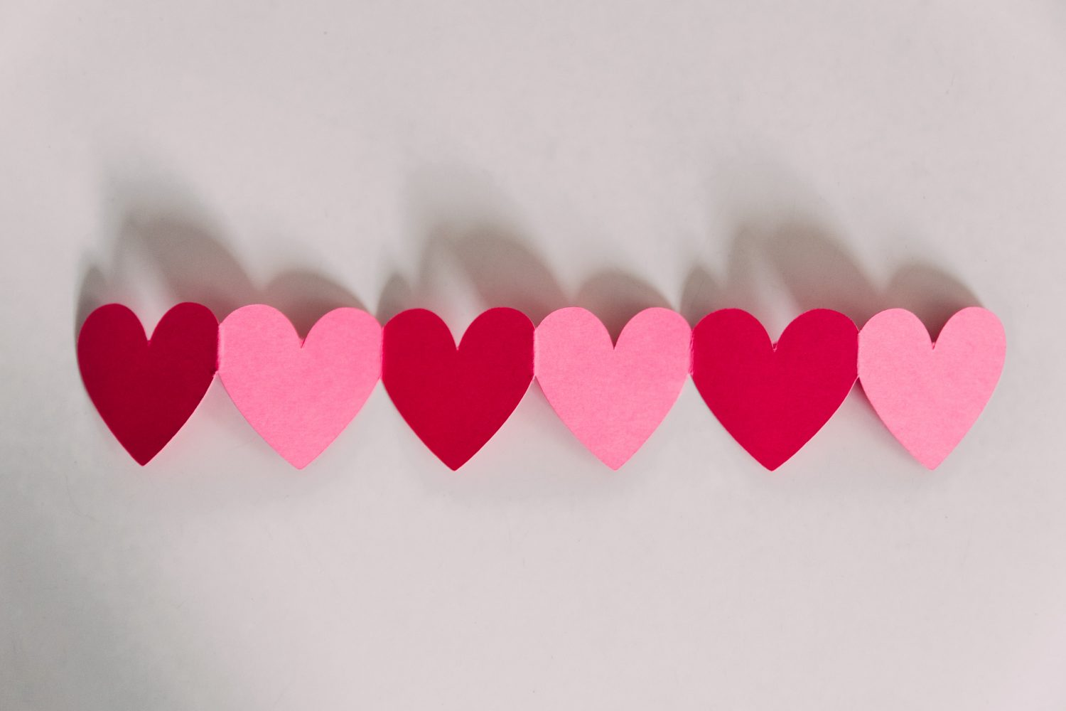 red and pink paper hearts by Kelly Sikkema