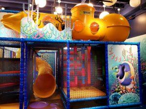 a play area decorated like an aquarium