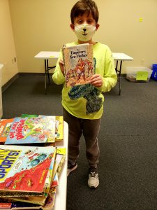 a child sorting books at the book buddy program