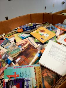 a bin of books for volunteer sorting at the book buddy program